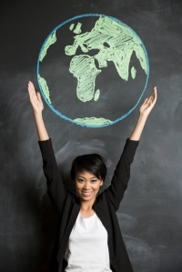 Asian woman with chalk globe drawn on blackboard.